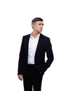 Young confident businessman looking away over white background Royalty Free Stock Image