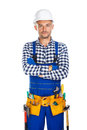 Young confident construction worker in uniform and tool belt wit Royalty Free Stock Photo