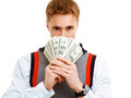 Young confident man holds dollars student holding Royalty Free Stock Images