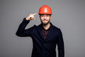 Young construction worker pointed on hard hat Royalty Free Stock Photo