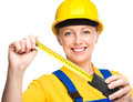 Young construction worker with tape measure happy lady as a isolated over white Stock Images