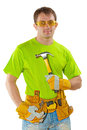 Young construction worker with tools holding claw hammer and loo Royalty Free Stock Photo