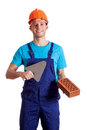 Young constructor with putty knife and brick isolated background Royalty Free Stock Image