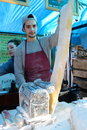 Young cook preparing long pastry in camden town market london Stock Photo