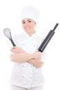 Young cook woman in uniform with baking rolling pin and corolla isolated on white background Stock Photos