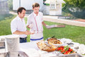 Young cooks are serving food on buffet at event kyiv ukraine – august party with fresh pilaf tomato caucasian males Stock Photos