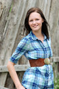 Young country woman with wooden fence Royalty Free Stock Photos