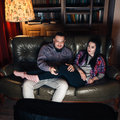 Young couple addicted to tv. Bad habit problem. Royalty Free Stock Photo