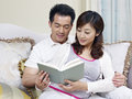Young couple asian reading a book together Stock Photography