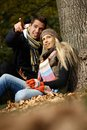Young couple at autumn Stock Images