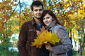 Young couple in the autumn yellow colors Royalty Free Stock Image