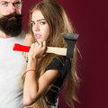 Young couple with axe Royalty Free Stock Photo
