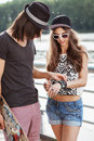 Young couple on the bank of a river girl shows boy her bracelets active people outdoors lifestyle Stock Photos
