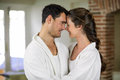 Young couple in bathrobe embracing each other romantic kitchen Royalty Free Stock Image
