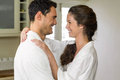 Young couple in bathrobe embracing each other romantic kitchen Royalty Free Stock Photos