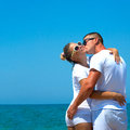 Young couple in the beach happy beautiful having fun on Stock Photo