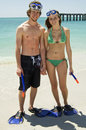 Young couple on beach snorkel Stock Photos