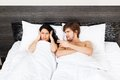 Young couple bed in bedroom lying at Stock Image