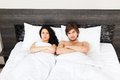 Young couple bed in bedroom lying at Royalty Free Stock Photo