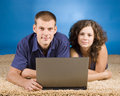 Young couple on beige carpet Stock Photo