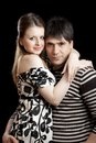 Young couple on black background Royalty Free Stock Images