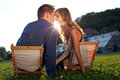 Young couple bonding in a park at sunset Royalty Free Stock Photos