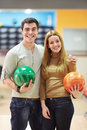 Young couple in bowling club Royalty Free Stock Photo