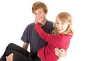 Young couple, boyfriend carrying girl in his arms Royalty Free Stock Photo
