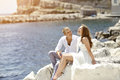 Young couple bride and groom smiling and relaxing near sea naples italy happy Stock Images