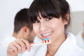 Young couple brushing teeth Royalty Free Stock Image