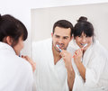 Young couple brushing teeth Royalty Free Stock Photo