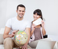 stock image of  Young couple buying travel tickets online