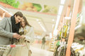 Young couple buying wine at big store Stock Photos