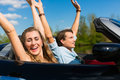 Young couple with cabriolet in summer on day trip Stock Photography