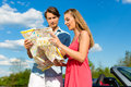 Young couple with cabriolet in summer on day trip Royalty Free Stock Images