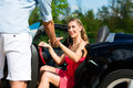 Young couple with cabriolet in summer on day trip Royalty Free Stock Image