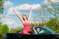 Young couple with cabriolet in summer on day trip hip man and woman convertible car a Stock Photography