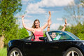 Young couple with cabriolet in summer on day trip hip man and woman convertible car a Stock Photos