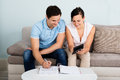 Young Couple Calculating Budget Royalty Free Stock Photo