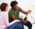 Young couple celebrating with a bottle of champagn Royalty Free Stock Photos