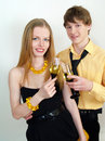 Young couple celebrating with champagne together Stock Photos