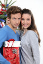 Young couple celebrating christmas together Royalty Free Stock Photos