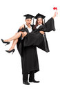 Young couple celebrating their graduation full length portrait of a isolated on white background Royalty Free Stock Photography