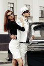Young couple with classic car retro on the city street Royalty Free Stock Image