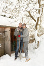 Young Couple Clearing Snow Royalty Free Stock Photo