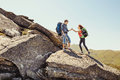 Young couple climbing in the mountains Royalty Free Stock Photo