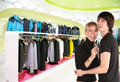 Young couple in clothes shop Royalty Free Stock Photos