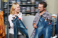 Young couple at clothes shopping Royalty Free Stock Image