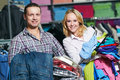 Young couple at clothes shopping Royalty Free Stock Photo