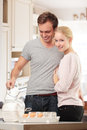 Young couple cooking in the kitchen together Stock Photo